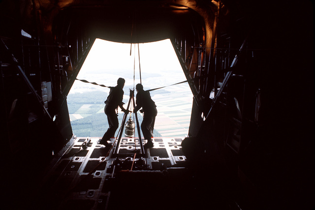 The 7th Special Operations Squadron (SOS) conducts training for special air operations and related activities. The unit also trains with Army Special Forces and Navy SEALS for unconventional warfare operations. Airmen retrieve a practice sandbag into an MC-130E Hercules Combat Talon aircraft during a Fulton recovery mission