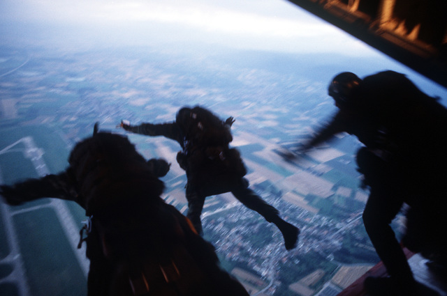 The 7th Special Operations Squadron (SOS) conducts training for special air operations and related activities. The unit also trains with Army special Forces and Navy SEALs for unconventional warfare operations. Combat controllers jump from an MC-130E Hercules Combat Talon aircraft during a Fulton recovery mission