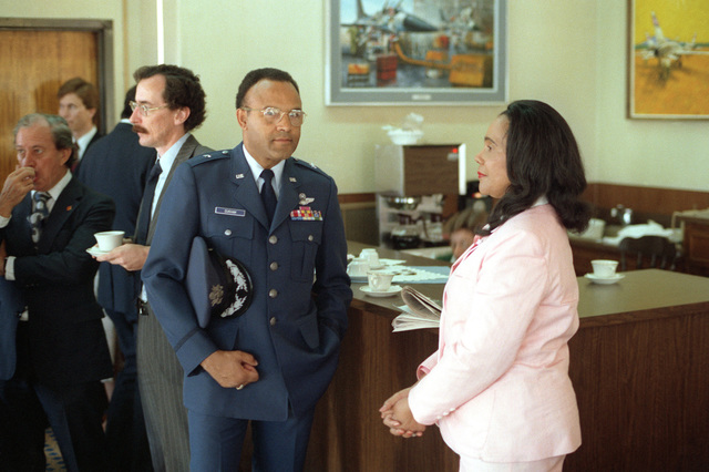 Corretta Scott King, widow of the late Rev. Martin Luther King., talks with BGEN Archer Durham after her arrival for a visit