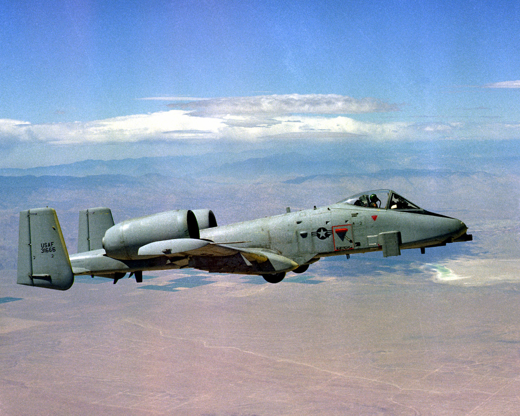 AN air-to-air right side view of an A-10 Thunderbolt II aircraft during an engine icing test