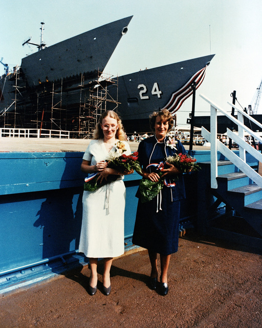 Dana Elaine Carr, sponsor's proxy and Fern William Carr, co-sponsor, right, stand in front of the USS JACK WILLIAMS (FFG 24) prior to the start of the launch ceremony for the Oliver Hazard Perry class guided missile frigate