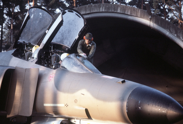 A crew chief cleans the canopy of an F-4E Phantom II aircraft during the exercise Crested Cap