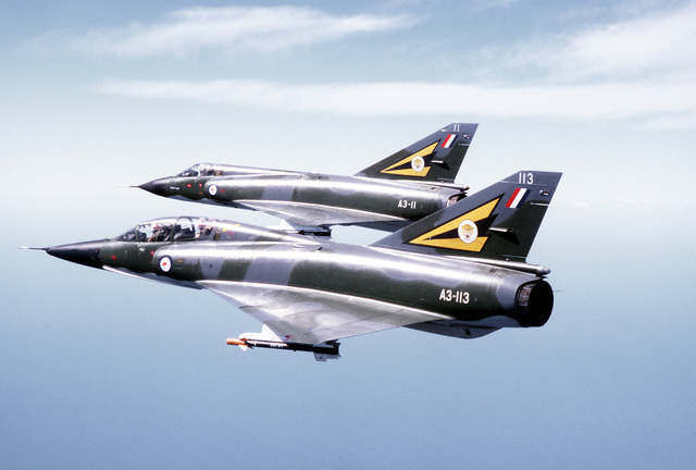 A left side view of a Mirage III D (top) and Mirage III E aircraft in flight during a combined U.S.-Australian Air Force exercise, Pacific Consort