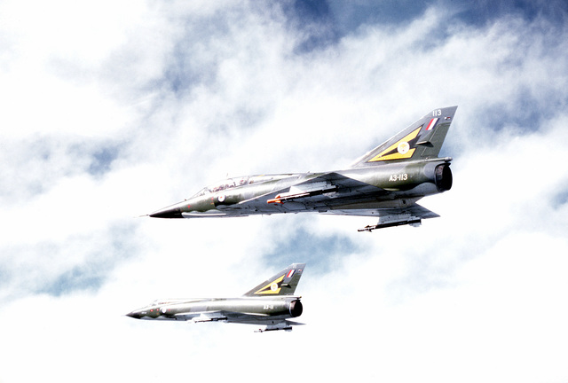 A left side view of two Royal Australian Air Force aircraft participating in a combined U.S.-Australian Air Force exercise Pacific Consort. The top aircraft is a Mirage III D and the bottom is a Mirage III E