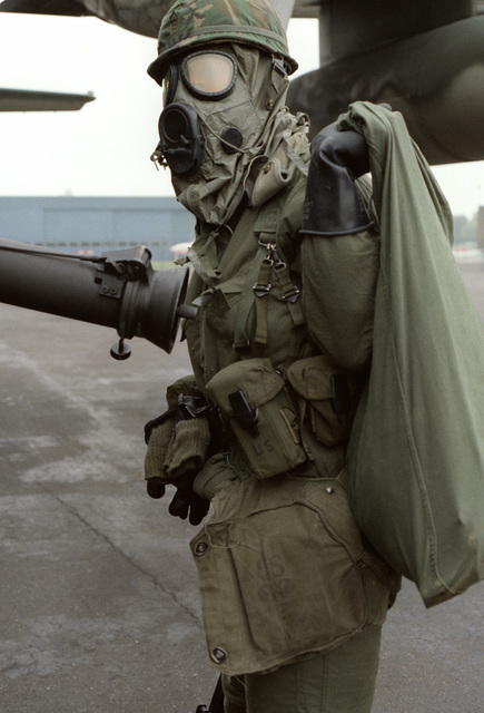 A member of U.S. Air Force 317th Combat Control Team in chemical warfare gear during exercise Reforger/Autumn Forge 1980. Autumn Forge is a reserve airdrop and associated ground movements taking place both here and in Germany and involving mostly U.S. and British troops and equipment