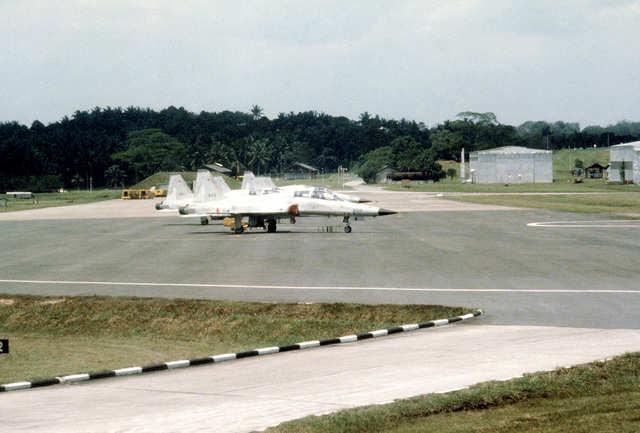A right front view of an F-5 Freedom Fighter aircraft of the Royal Singapore Air Force, parked on a ramp