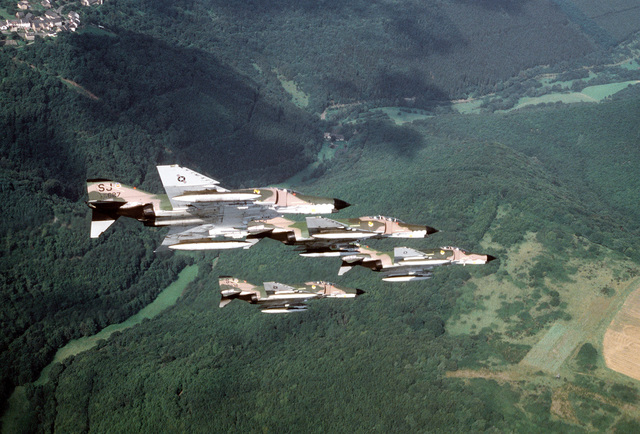 A right side view of four F-4E Phantom II aircraft banking to the left during the exercise Crested Cap. The aircraft are assigned to the 4th Tactical Fighter Wing
