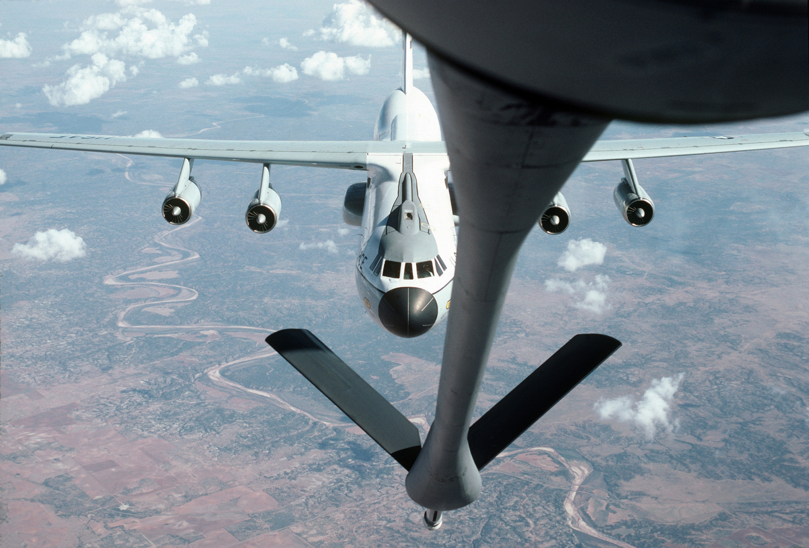 A view from the refueling boom control station aboard a 452nd Air Refueling Wing KC-135 Stratotanker as a C-141B Starlifter aircraft approaches to be refueled in flight over Altus Air Force Base. Both aircraft are manned by Air Force Reserve crews