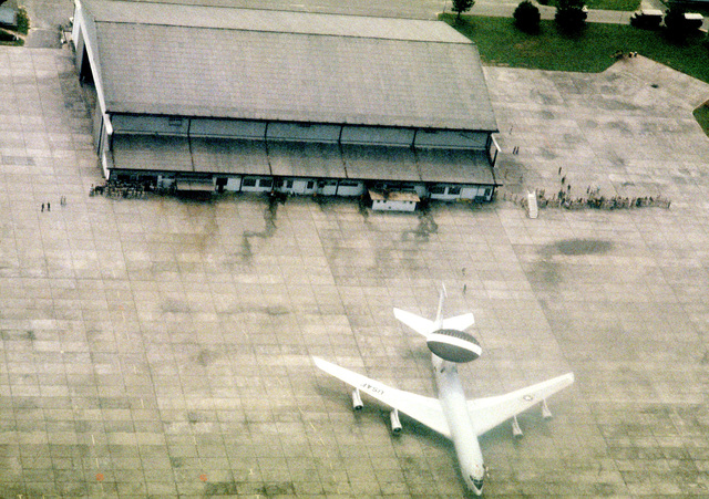 Aerial view of the hangar and ramp area, where an E-3A airborne warning and control system aircraft is parked