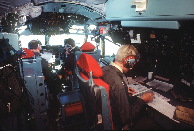 An Air Force Reserve flight crew works in the cockpit of a 452nd Air Refueling Wing KC-135 Stratotanker aircraft during a refueling operation over Altus Air Force Base