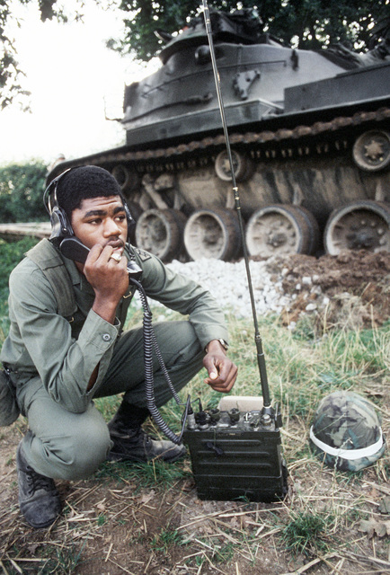 An Army gunner of the Armor Group makes radio contact during the exercise Golden Thunder