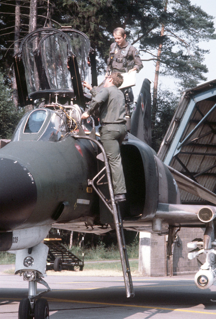 AN F-4E Phantom II pilot of the 4th Tactical Fighter Wing and a crew chief conduct a preflight inspection of the aircraft during exercise Crested Cap