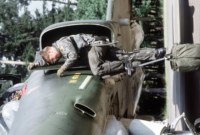 AN F-4E Phantom II pilot of the 4th Tactical Fighter Wing climbs into his aircraft during the exercise Crested Cap