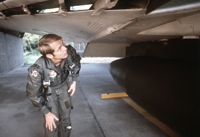 CPT Mark Wright, an F-4E Phantom II pilot of the 336th Tactical Fighter Squadron, makes a preflight inspection of the aircraft during the exercise Crested Cap
