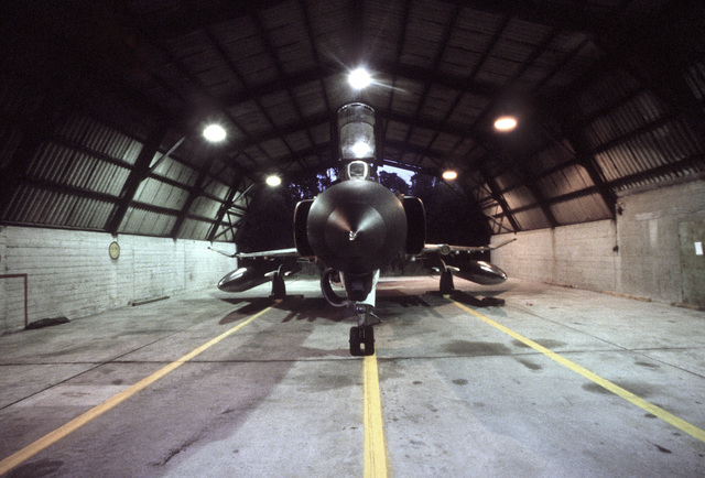 Front view of an F-4E Phantom II aircraft parked in a shelter during the exercise Crested Cap