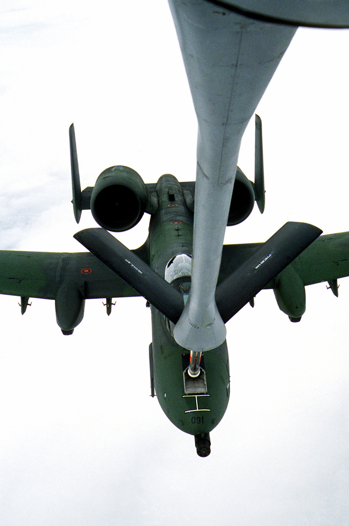 High angle front view of an A-10 Thunderbolt II aircraft, assigned to the 81st Tactical Fighter Wing, being refueled in flight by a KC-135 Stratotanker aircraft assigned to the 306th Strategic Refueling Wing
