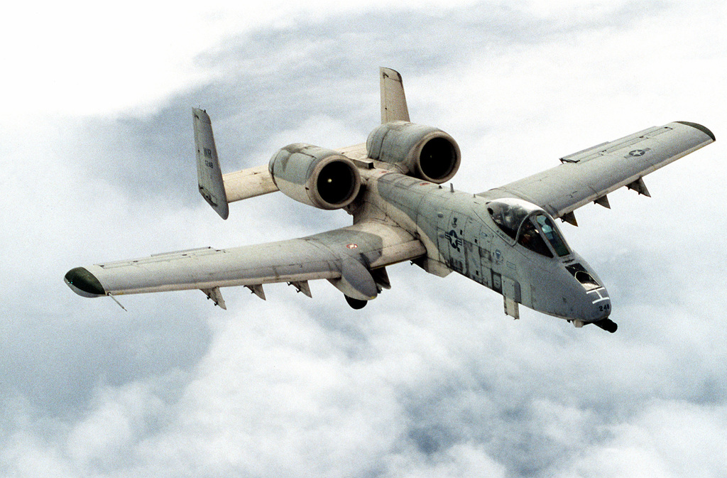 High angle right side view of an A-10 Thunderbolt II aircraft assigned to the 81st Tactical Fighter Wing in flight