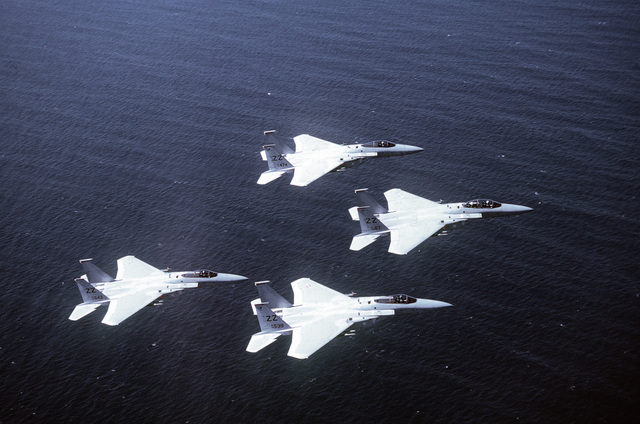 Overhead view of four F-15 Eagle aircraft of the 67th Tactical Fighter Squadron flying in formation