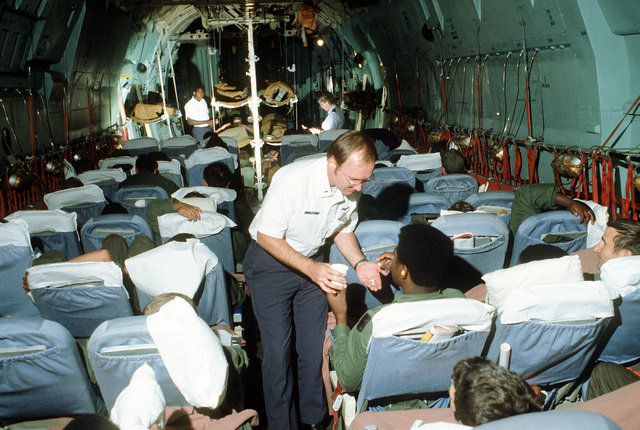Patients are aboard a C-141 Starlifter aircraft, ready to take-off, during exercise Reforger '80