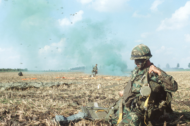Troops from the 82nd Airborne Division are dropped by parachute during exercise Reforger '80