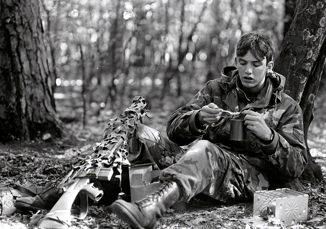 A1C Todd Adkins 435th Security Police Squadron, takes a dinner break during exercise Reforger '80