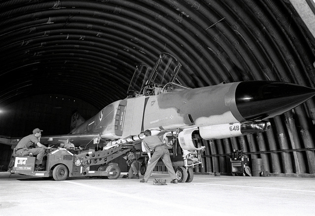 AN F-4E Phantom II aircraft is being uploaded with missiles during exercise Crested Cap