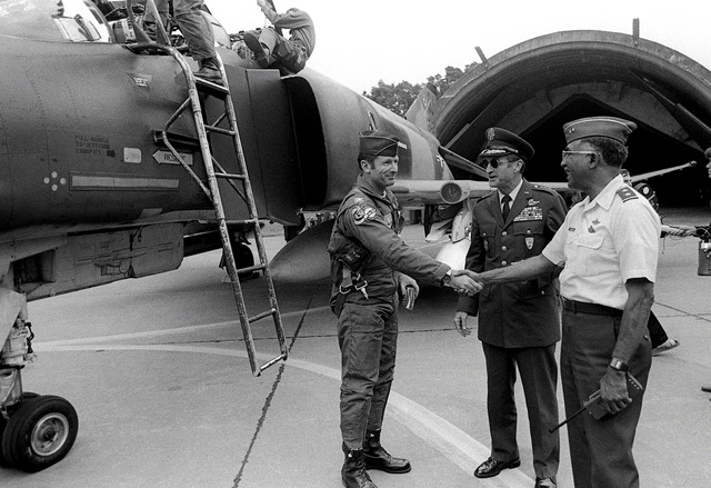 COL Peter T. Kempf, 4th Tactical Fighter Wing commander, is greeted by MGEN William Brown and GEN Charles Gabriel during exercise Reforger '80. Brown is commander, 17th Air Force, and Gabriel is commander in chief, USAFE