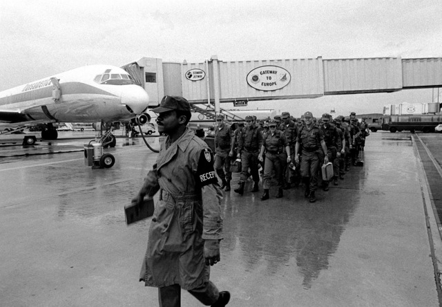 SSGT John Redden, 3rd Movement Battalion, directs the march of newly-arrived troops during exercise Reforger '80