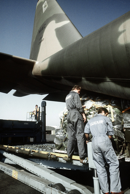 Natives help unload cargo from a U.S. Air Force C-130 Hercules aircraft onto a loader during exercise Reforger '80