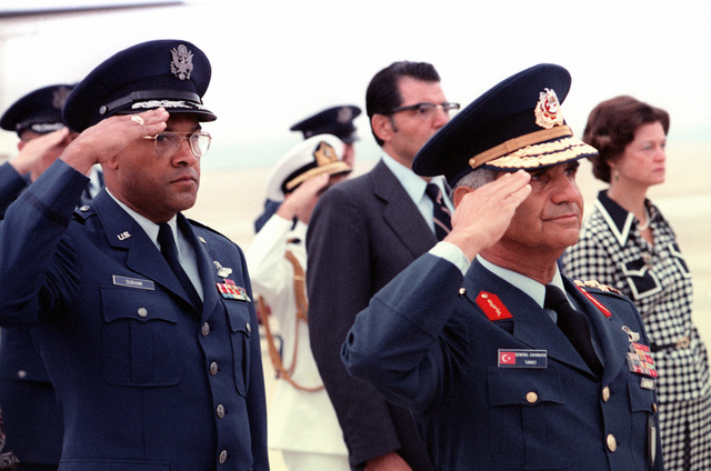 GEN Sahinkaya, commander of the Turkish Air Force (right), and BGEN Archer Durham salute during the welcoming ceremony