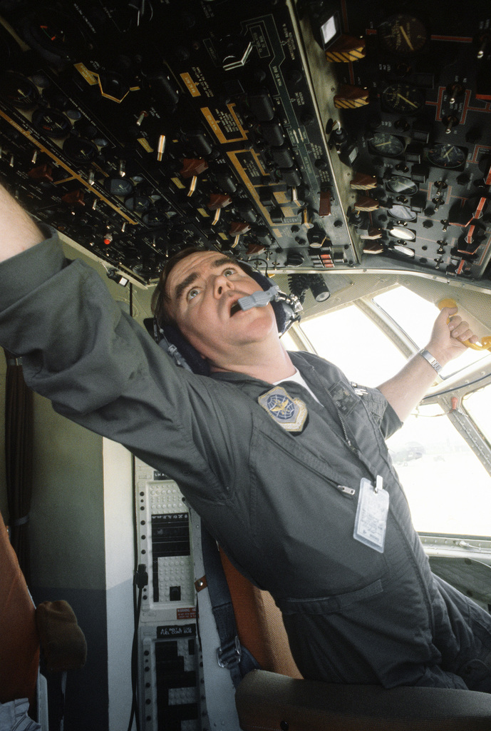 A flight engineer, 345th Tactical Airlift Squadron, makes a preflight check on aircraft's instrument panel during exercise Purple Duck, a deployment from Yokota Air Base, Japan, to Kwang Ju Air Base, Korea, for joint operation readiness maneuvers with Korean troopers
