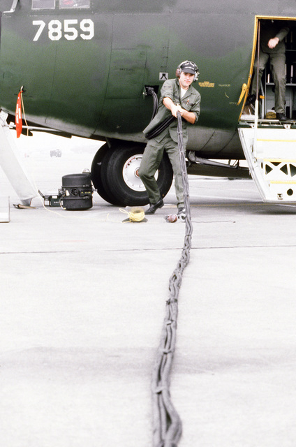 A senior airman, 316th Organizational Maintenance Squadron, attaches a multi-conductor cable of an engine analyzer to a C-130 Hercules aircraft during exercise Purple Duck, a deployment from Yokota Air Base, Japan, to Kwan Ju Air Base for joint operation readiness maneuvers with Korean troopers