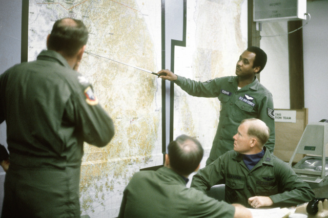 A technical sergeant briefs an intelligence activities team during exercise Purple Duck, a deployment from Yokota Air Base, Japan, to Kwang Ju Air Base for joint operation readiness maneuvers with Korean troopers