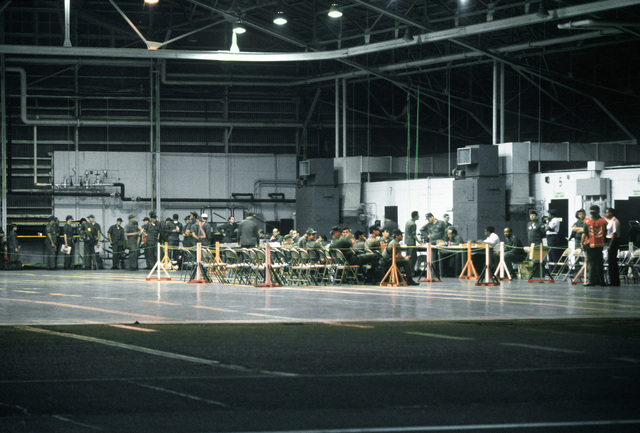 Airmen are processed in a hangar during exercise Purple Duck, a deployment from Yokota Air Base, Japan, to Kwang Ju Air Base for joint operation readiness maneuvers with Korean troopers