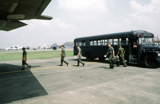 Airmen transfer from a U.S. Air Force bus to a C-130 Hercules aircraft during exercise Purple Duck, a deployment from Yokota Air Base, Japan, to Kwang Ju Air Base, Korea, for joint operation readiness maneuvers with Korean troopers