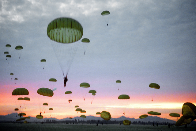 Korean paratroopers descend toward a drop zone during exercise Purple Duck, a deployment from Yokota Air Base, Japan, to Kwang Ju Air Base for joint operation readiness maneuvers with Korean troopers