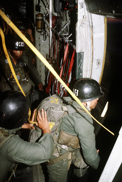 Korean paratroopers prepare to jump from a C-130 Hercules aircraft during exercise Purple Duck, a deployment from Yokota Air Base, Japan, to Kwang Ju Air Base, Korea, for joint operation readiness maneuvers with Korean troopers