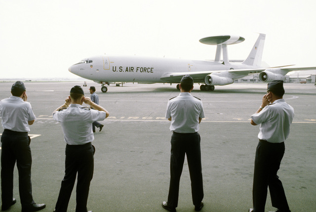 U.S. Air Force officers watch as an E-3A advanced airborne command post (AABNCP) aircraft enters a parking ramp during exercise Purple Duck, a deployment from Yokota Air Base, Japan, to Kwang Ju Air Base, Korea, for joint operation readiness maneuvers with Korean troopers