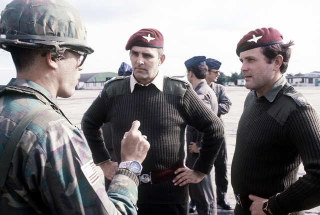 82nd Airborne Division and British paratroopers discuss the procedures of their joint air jump into Arnhem, the Netherlands, to participate in an annual Market Garden (1944 Arnhem Drop) memorial service on Sept. 21
