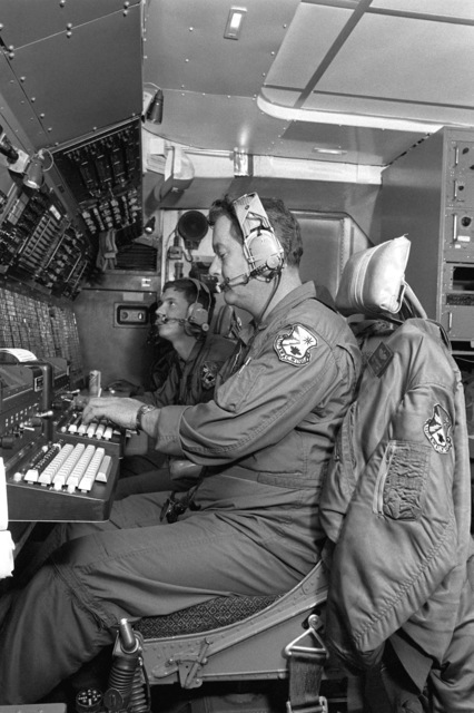 Airmen of the 7th Airborne Command and Control Squadron monitor a communications station aboard an aircraft in flight during Cold Fire '80. The joint Army/Air Force tactical exercise in Europe was conducted Sep. 15-26