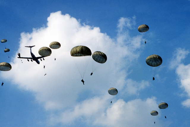 82nd Airborne Division members parachute from a C-141B Starlifter aircraft during exercise Reforger '80