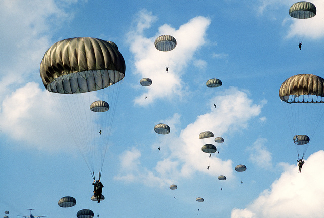 Members of the 82nd Airborne Division parachute from a C-141B Starlifter aircraft during exercise Reforger '80
