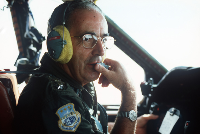 Major General (MGEN) Richard Bodycombe, commander, Air Force Reserve, left, completes a preflight check in the cockpit prior to a mission involving an all-reserve crew refueling a C-141B Starlifter aircraft