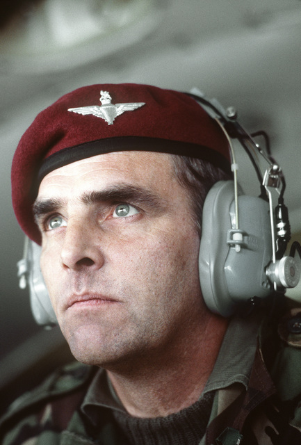 A portrait of British Air Force LTC Martin, a leader of 10 paratroopers, aboard a C-130 Hercules aircraft, in flight. 82nd Airborne Division and British paratroopers will participate in an annual Market Garden (1944 Arnhem Drop) memorial service on Sept. 21