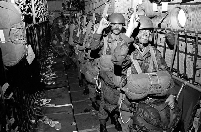 British paratroopers prepare to jump from an in-flight aircraft during exercise Reforger/Autumn Forge '80. Autumn Forge is a reserve airdrop involving mostly U.S. and British troops and equipment