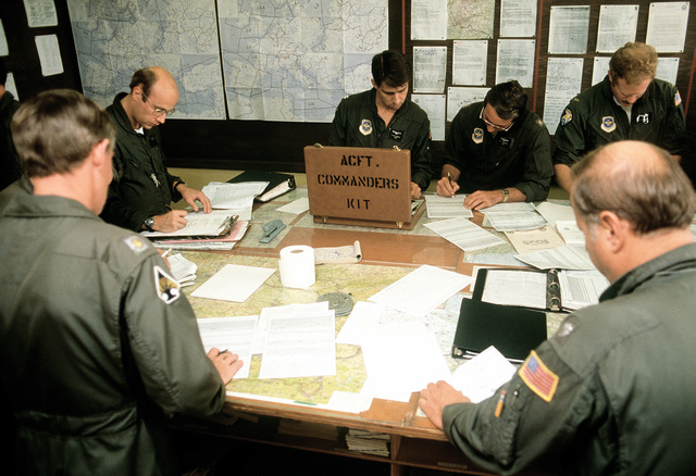U. S. Air Force Reserve and Air National Guard aircrew personnel participate in pre-planning for exercise Reforger/Autumn Forge '80. Autumn Forge will be a reserve airdrop near the base involving mostly U.S. and British troops and equipment
