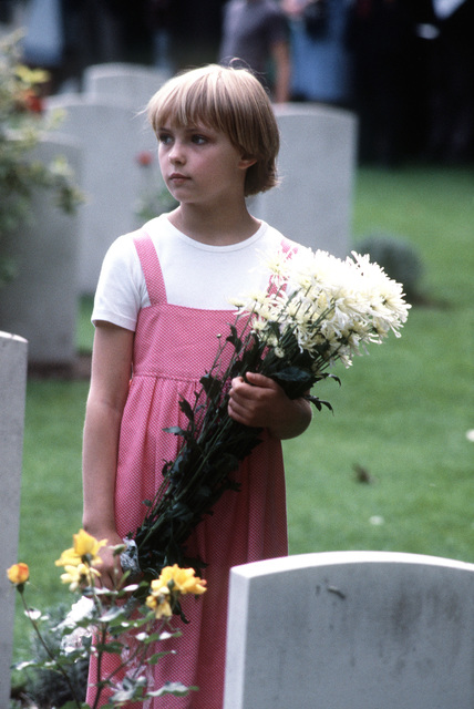 A Dutch child holds flowers to be placed on the graves during the 36th Annual Remembrance of the Battle of Arnhem