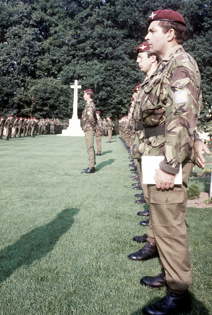 British troops stand at attention during the 36th Annual Remembrance of the Battle of Arnhem as U.S. 82nd Airborne Division members, in the background, stand by