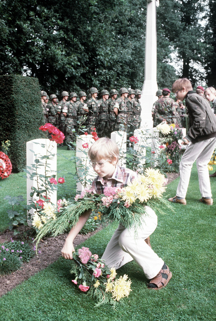 Dutch children placed flowers by the graves during the 36th Annual Remembrance of the Battle of Arnhem