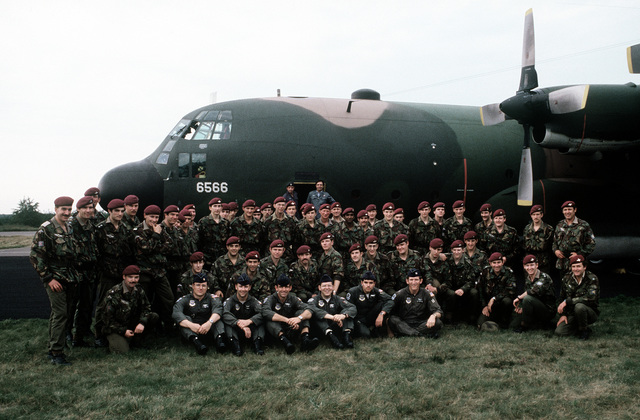 The 37th Tactical Airlift Squadron C-130 Hercules aircrew pose with British paratroopers beside the aircraft. The U.S. Air Force flew the troopers and their participants, the U.S. 82nd Airborne Division, to Arnhem to perform at an annual Market Garden (1944 Arnhem Drop) memorial service on Sept. 21